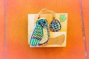 Painting owls on stone