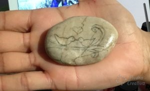 Draw the birds on the stone with a pencil