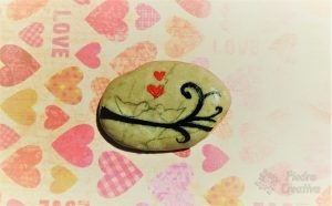 Paint the hearts and branch on the stone