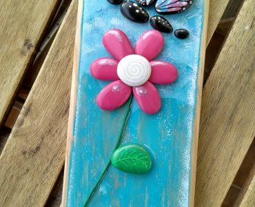 Como pintar flores con piedras