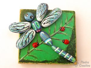 Dragonflies painted on stones