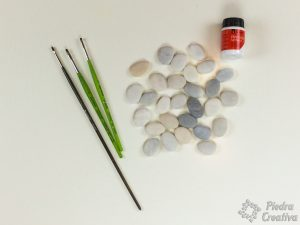 Stones, paint and brushes for dominoes