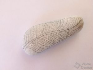 DIY feather drawn in stone