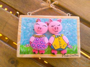 Manualidad de cerdos en piedras con madera de palet