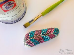 Stone craft with painted and varnished feather