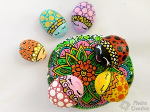 Ladybugs painted on stones