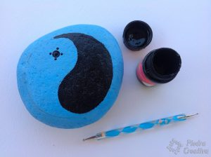 Yin Yang blue and black in stone