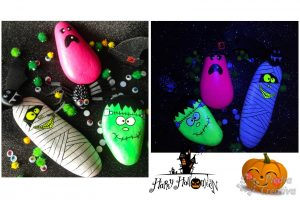 Stone monsters painted with black and fluorescent light